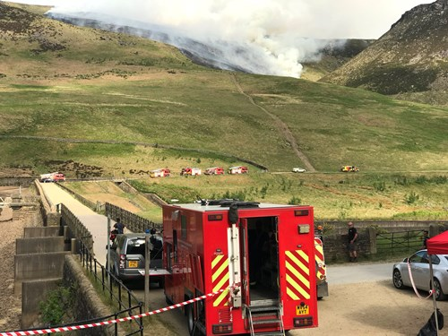Fire Service vehicles on the scene of the wildfire above Dove Stone Reservoir