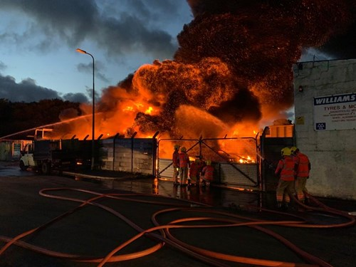 Photograph of firefighters putting out the fire at the industrial yard in Ince